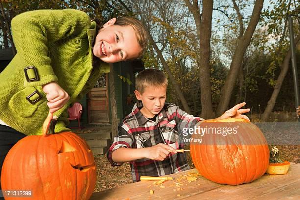 Happy Kids Having Fun Carving Halloween Pumpkin Hz