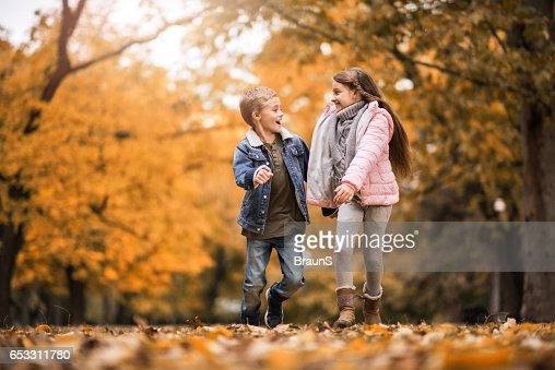 Happy kids having fun while running and talking in nature. : Stock-Foto
