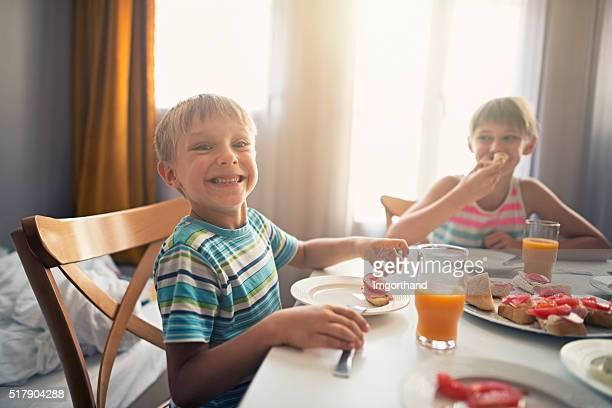 Happy kids having healthy breakfast