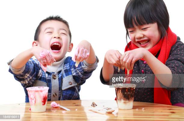 happy kids playing with ice cream