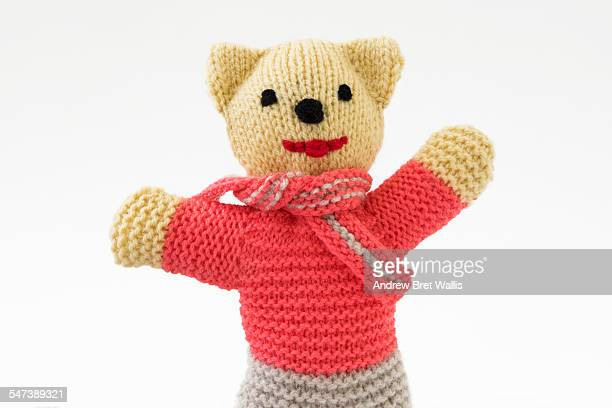 Happy knitted teddy bear