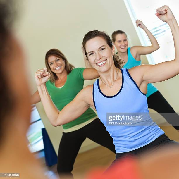 Happy ladies exercising during fitness class