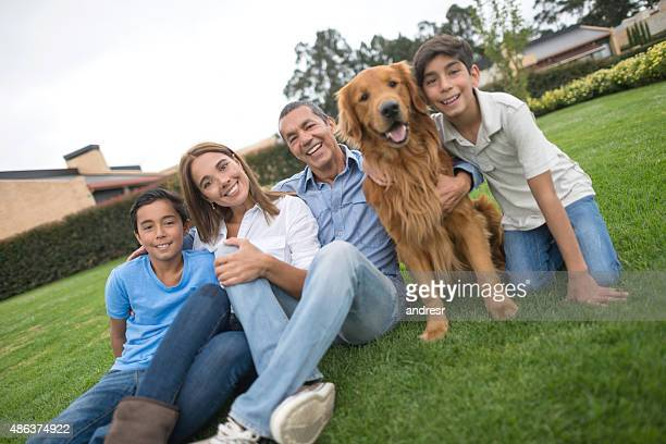 Happy Latin American family with a dog