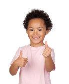 Happy latin child saying Ok isolated on white background