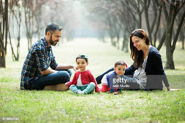 Happy latin family enjoying time outdoors