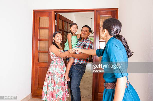 Happy latino family with their new home