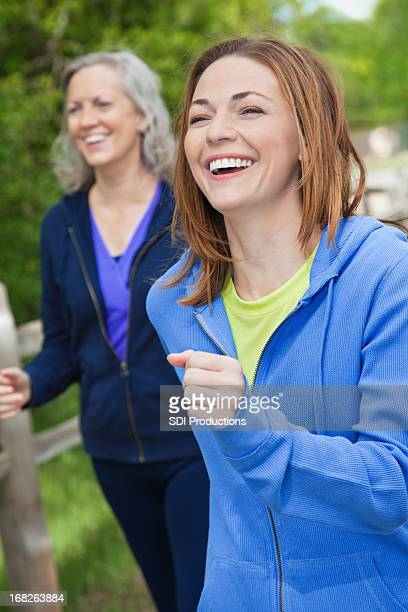 Happy Laughing Women Speed Walking Outside on Path