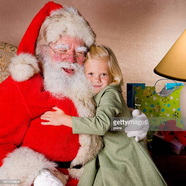 Happy little blond girl with Santa