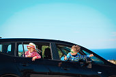 happy little boy and girl enjoy travel by car at sea, family car travel