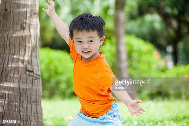 Happy little boy practicing martial arts outdoors