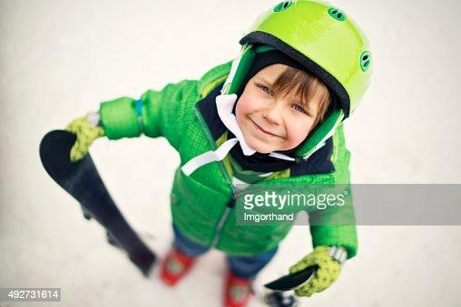 Happy little boy skiing