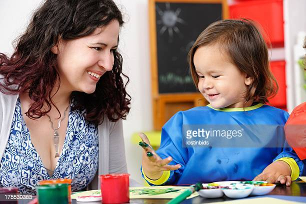 Happy Little Boy/ Toddler Enjoying Finger Painting With Carer/ Parent
