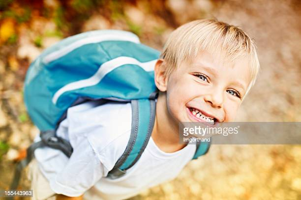 Happy little boy with backpack