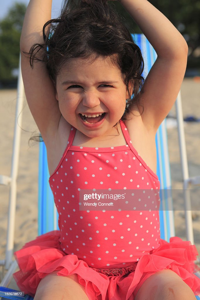 Happy little girl at beach : Stock Photo