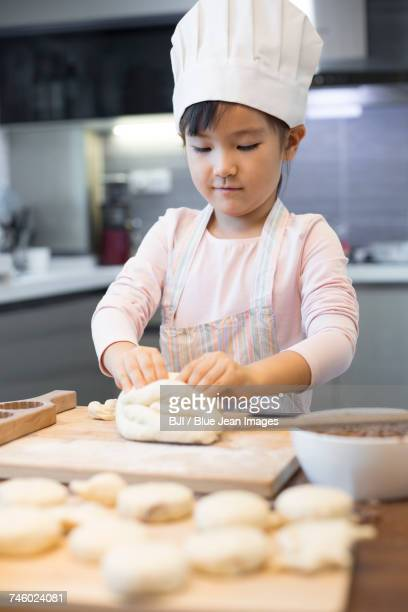 Happy little girl baking at home