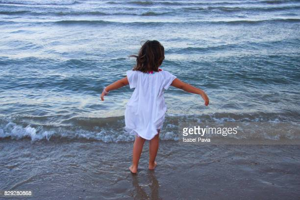 Happy little girl by the sea