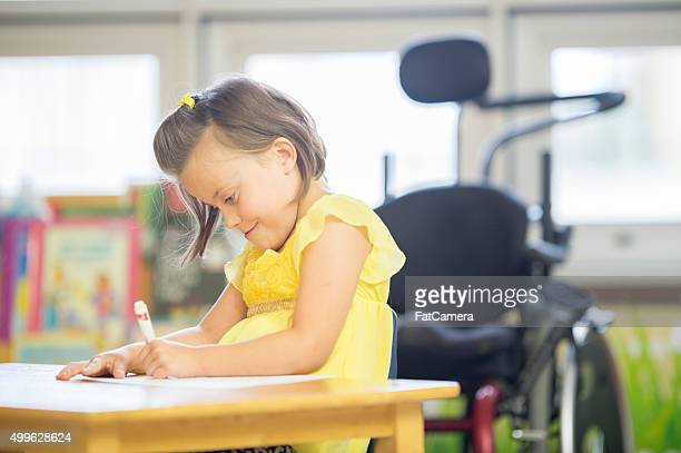 Happy Little Girl Coloring a Picture