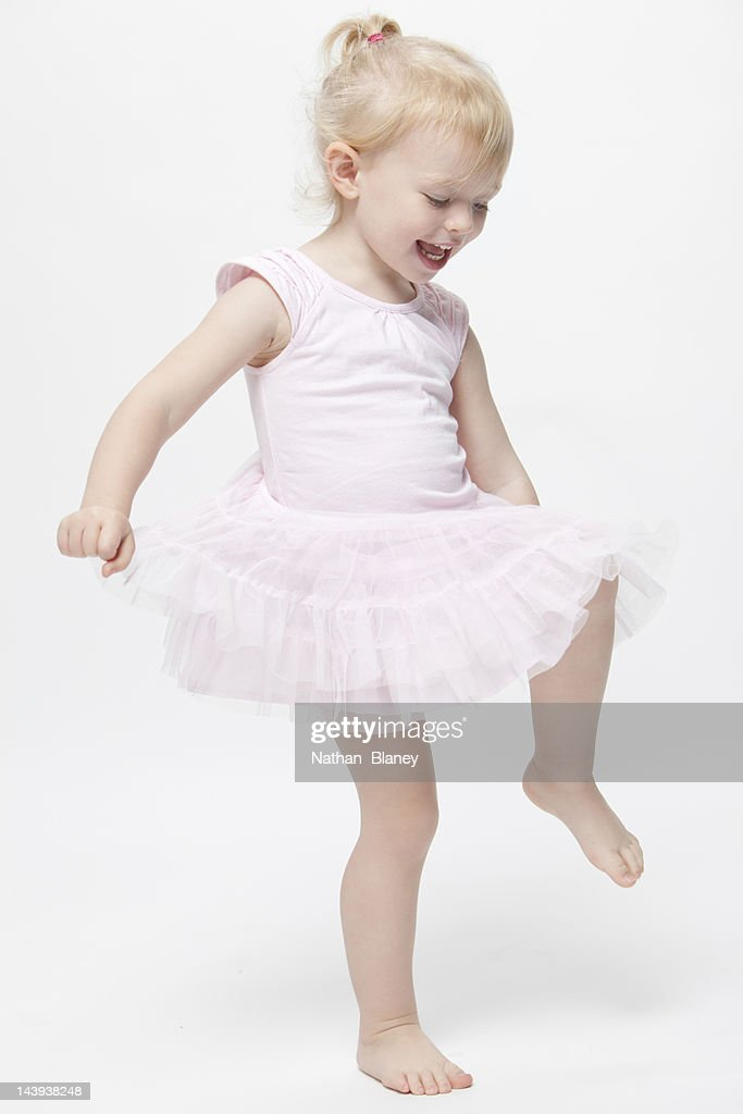 Happy little girl dancing : Stock Photo