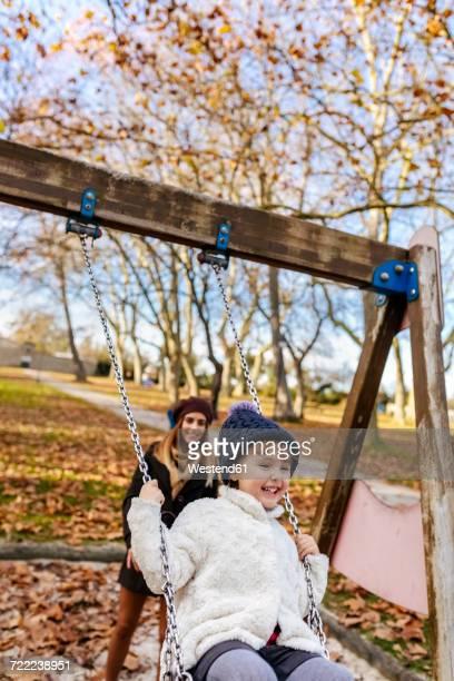 Happy little girl on a swing