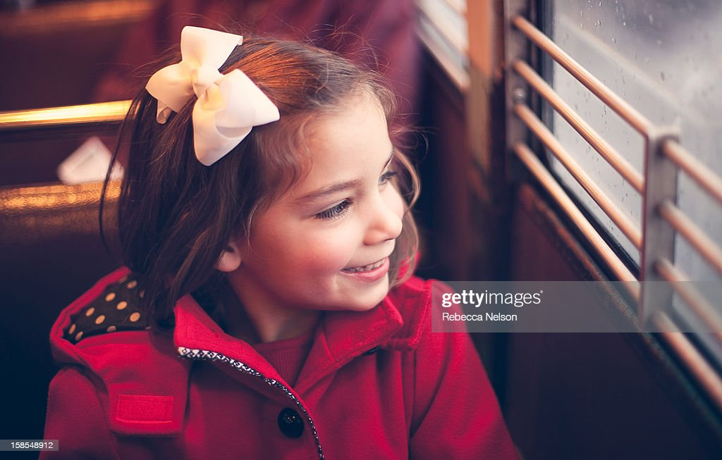Happy Little Girl on a Train : Stock Photo
