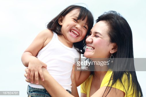 happy little girl play with her mom