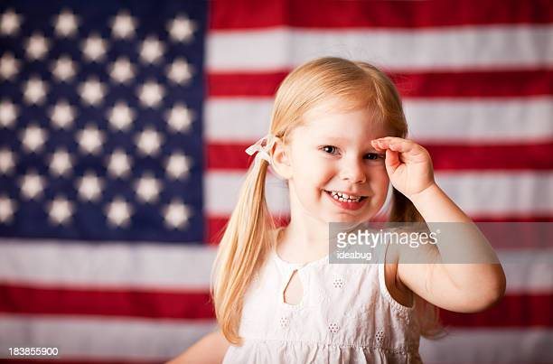 Happy Little Girl Saluting with American Flag