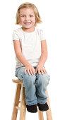 Happy Little Girl Sitting On Stool