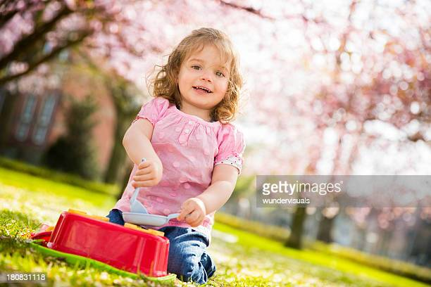Happy little girl smiling in the park