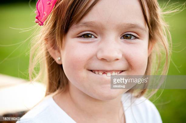 Happy Little Girl Smiling with Missing Tooth
