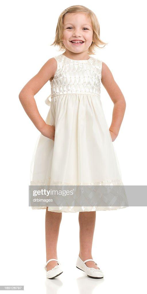 Happy Little Girl Standing In Dress