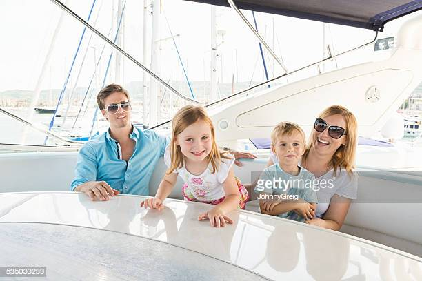 Happy Little Girl While Family Sitting In Yacht