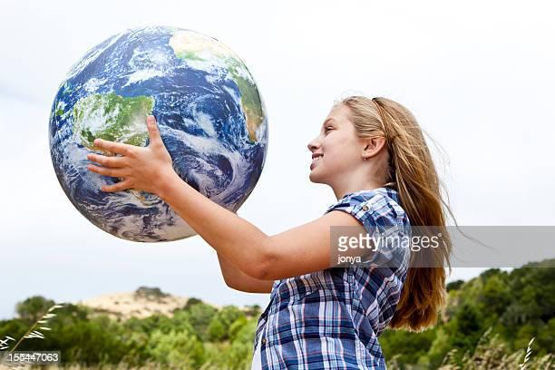 happy little girl with globe