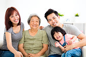 happy little girl with her grandmother and parent