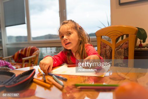 Happy Little Girl with Long Hair Drawing in the Room : Stock Photo