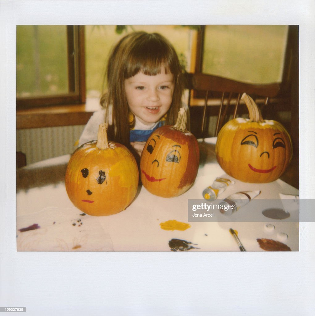 Happy Little Girl with Painted Halloween Pumpkins : Stock Photo