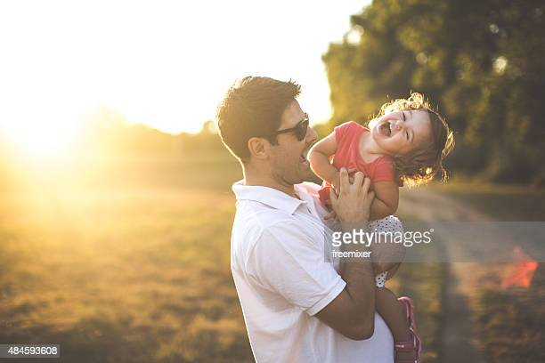 Happy little toddler girl with her father
