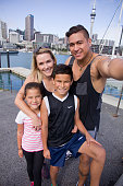 Family concept - happy mixed race local family relaxing and taking a selfie photo together in Auckland New Zealand