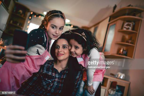 Happy Loving Family, Mother Embraced with her Two Daughters Making Selfie During Cooking Time
