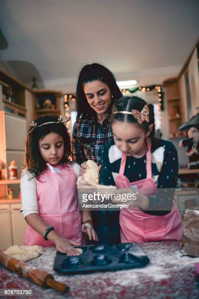 Happy Loving Family, Mother Teaching Two Daughters How To Bake and Having Great time