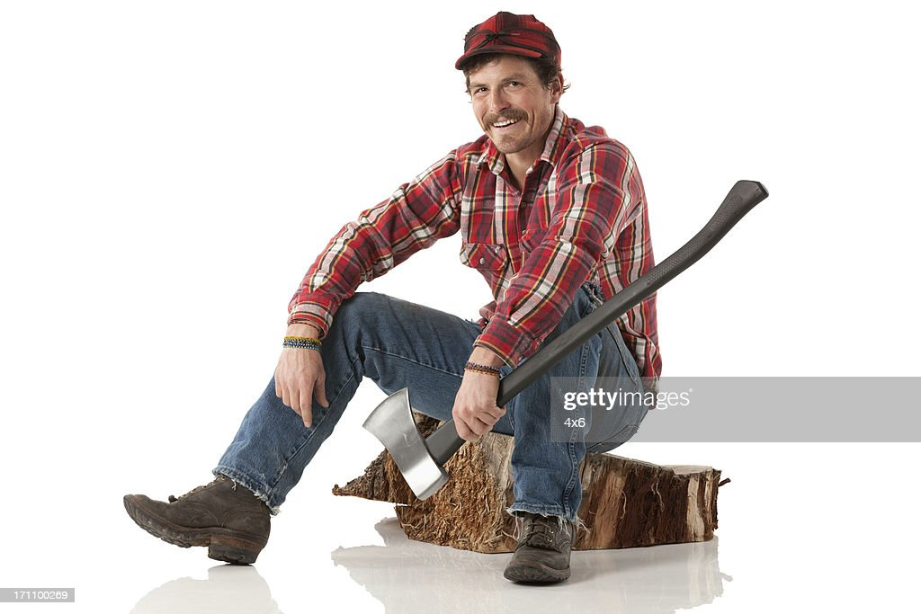 Happy lumberjack sitting on a log with an axe