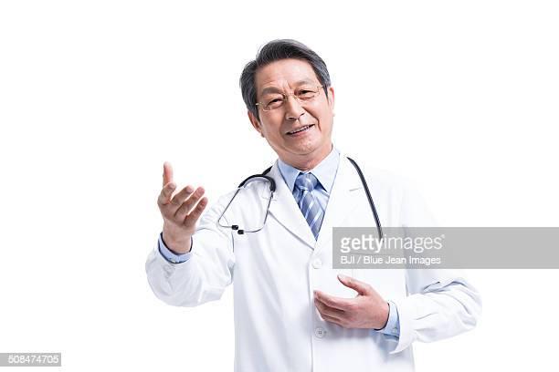 Happy male doctor talking