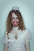 Happy Male Prom queen in drag tiara on head lipstick