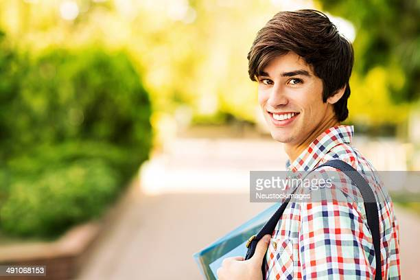 Happy Male Student On College Campus