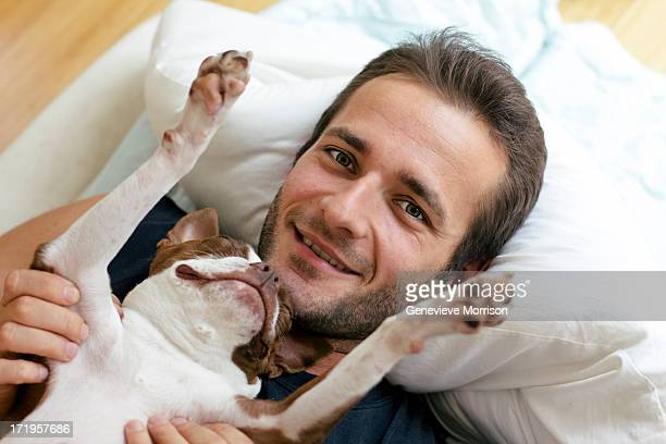 Happy man and sleeping boston terrier