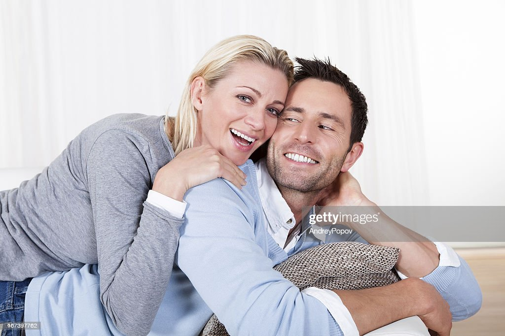 Happy man and woman cuddling : Stock Photo
