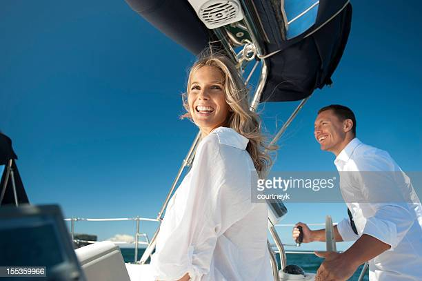 Happy man and woman on a sailboat