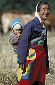 Happy Man Carrying Baby