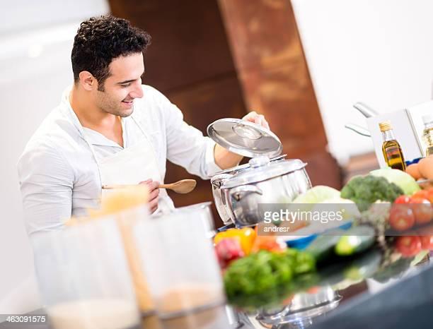 Happy man cooking dinner