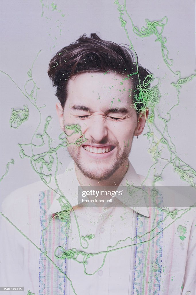 Happy man covered by silly string