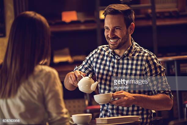 Happy man enjoying in tea time with his girlfriend.